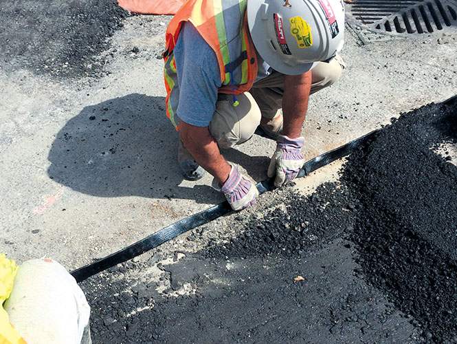 Premband used to seal vertical joints between asphalt, concrete and steel in road repair and construction