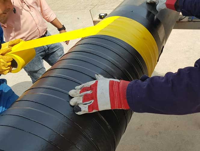 Premcote-R Tape being overwrapped with Premier Self-Adhesive PVC Tape