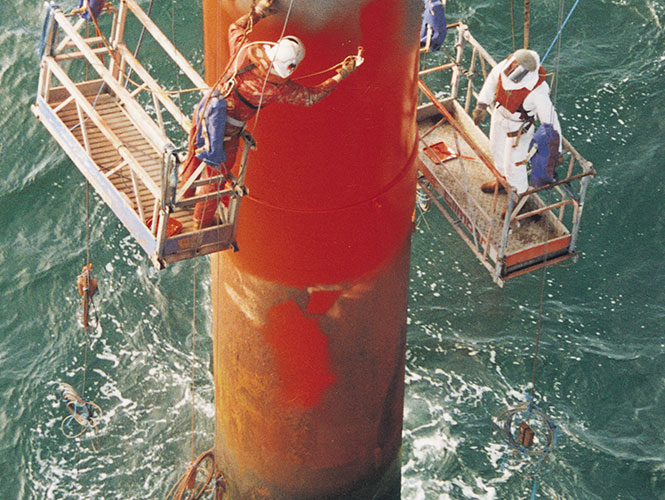 SeaShield Rigspray being applied to a marine pile