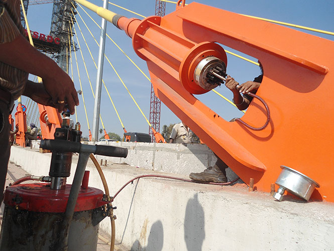 Premier™ Void Filler Type I is pumped hot or cold into tensioning cables of bridge